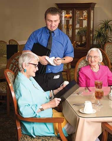 Seniors ordering a lovely meal at Burr Ridge Senior Living