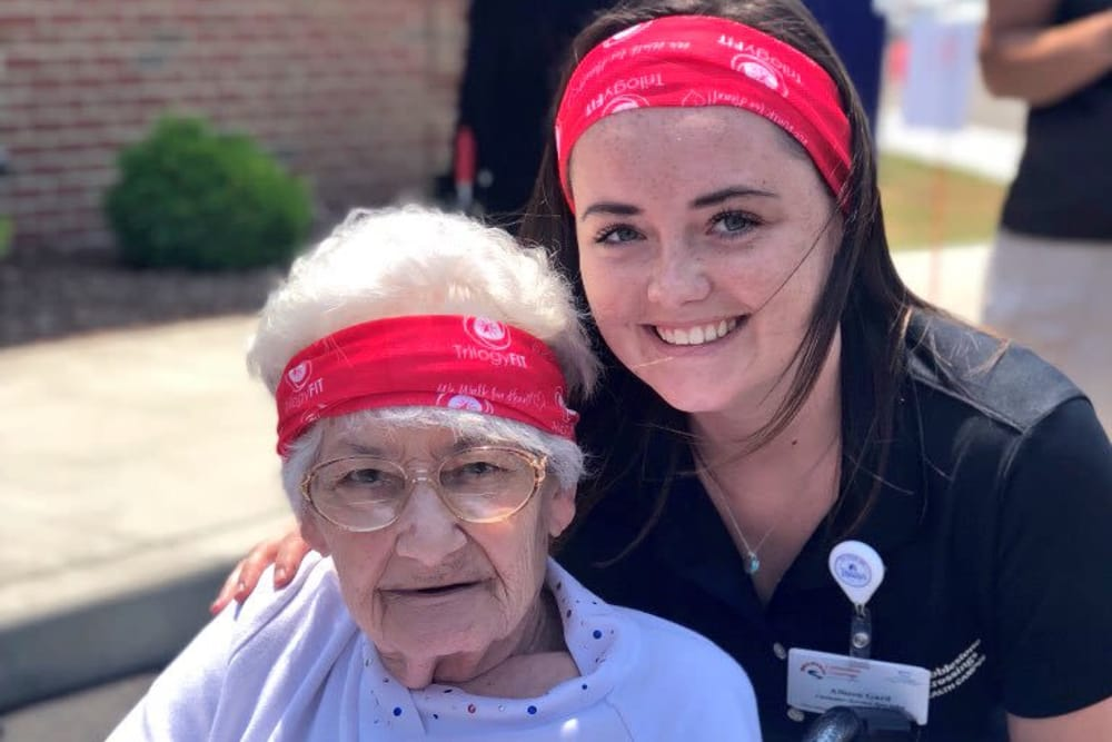 A resident and caretaker at Cobblestone Crossings Health Campus in Terre Haute, Indiana