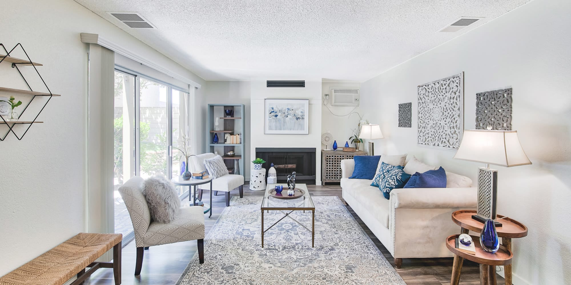 Natural light filling the living space of an open-concept model home at Mediterranean Village Apartments in Costa Mesa, California