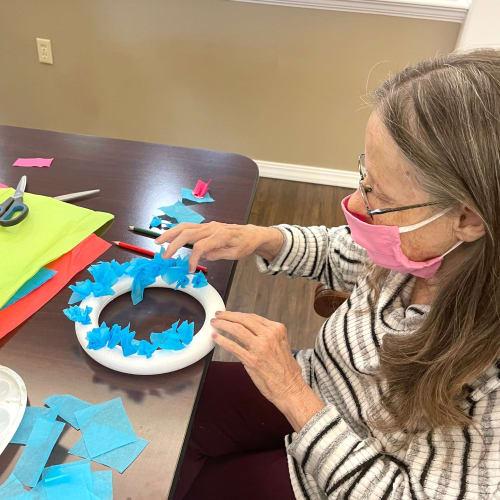 Resident crafting at Madison House in Norfolk, Nebraska