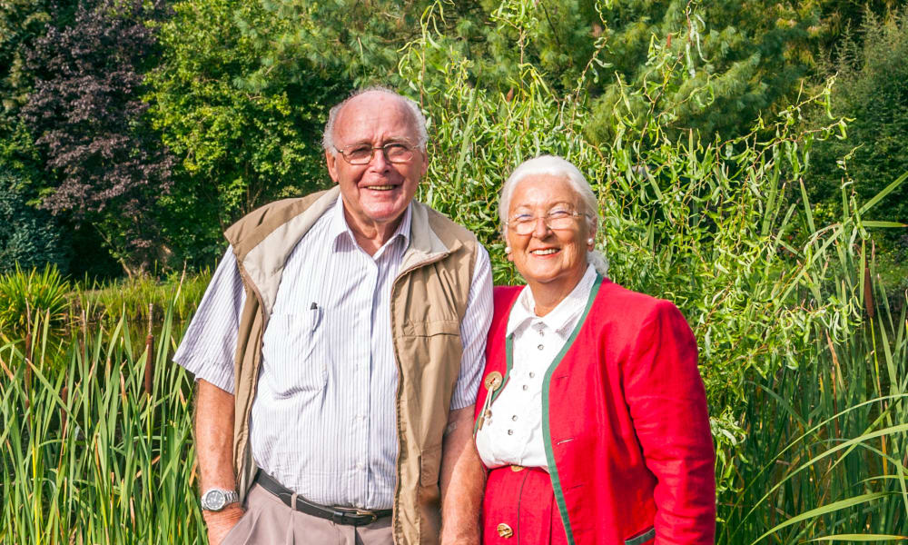 Two happy residents enjoying the outdoors at Honeysuckle Senior Living in Hayden, Idaho