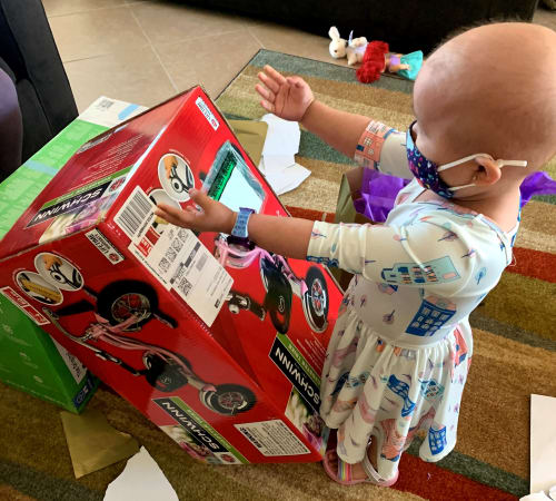 young child opening gifts