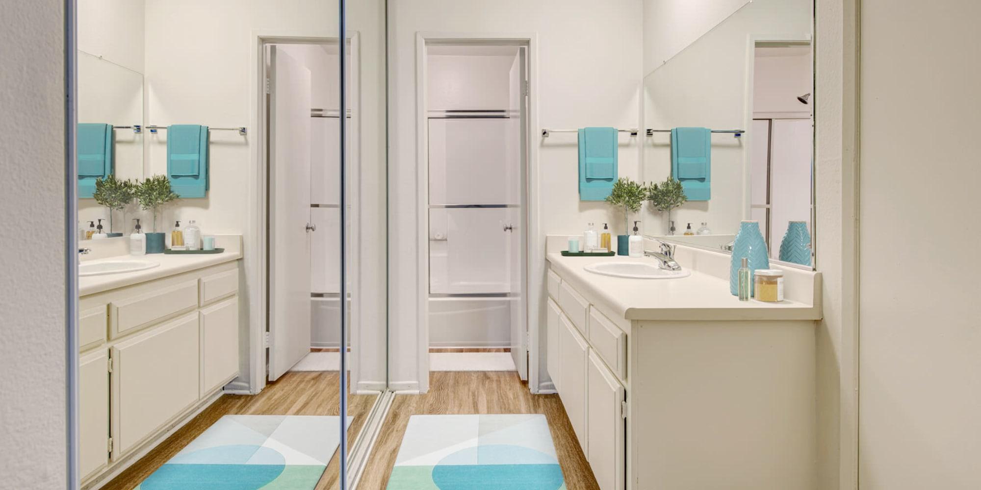 Mirrored closet doors in a model apartment's bathroom at Village Pointe in Northridge, California