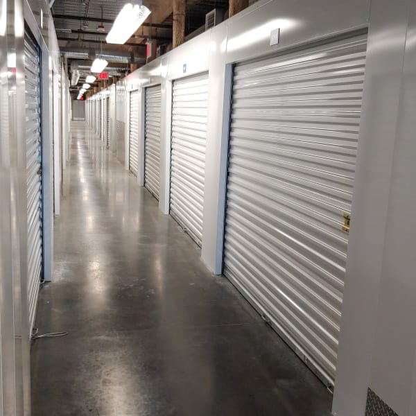 Drive-up access units with red doors at StorQuest Self Storage in North Miami, Florida