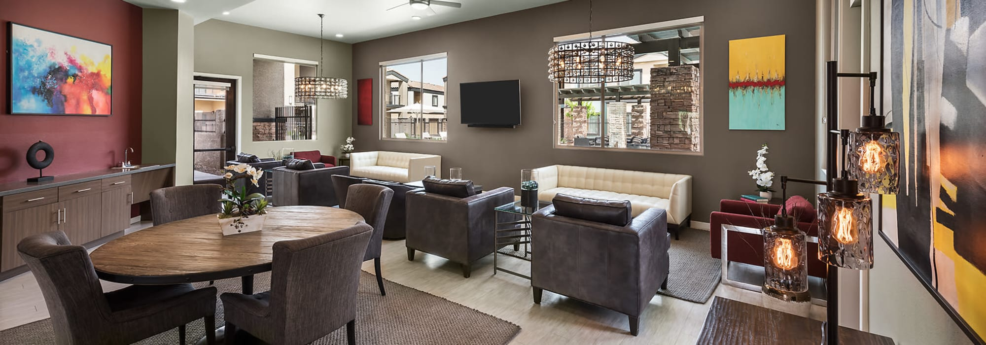 Apartment clubhouse with lounge at The Maxx 159 in Goodyear, Arizona