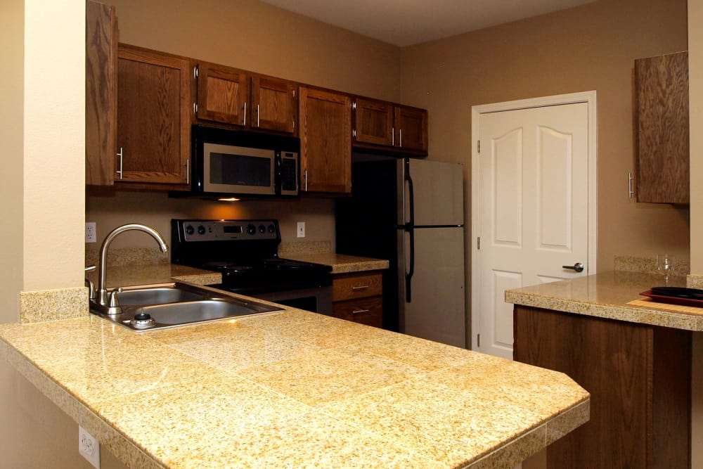 Model kitchen with large counter at Cortland Village Apartment Homes in Hillsboro, Oregon