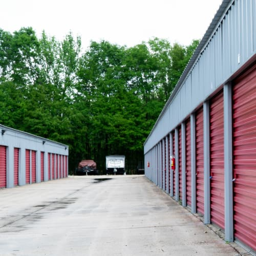 Storage units and outdoors boat and RV parking with wide driveways at Red Dot Storage in Denham Springs, Louisiana