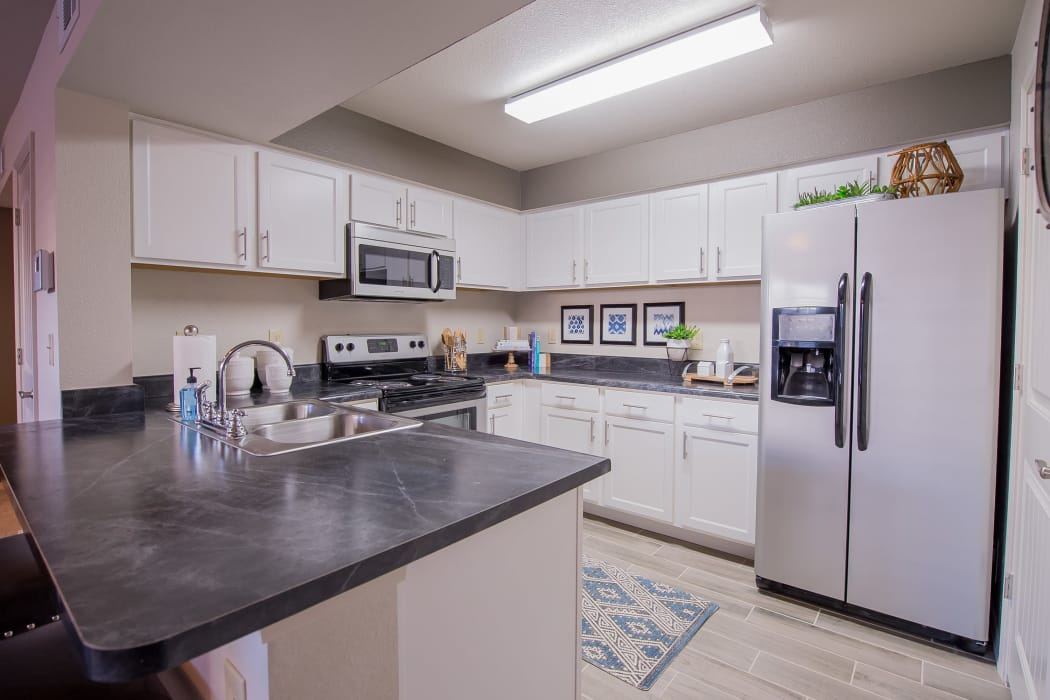 Well-lit kitchen at Cottages at Tallgrass Point Apartments in Owasso, Oklahoma