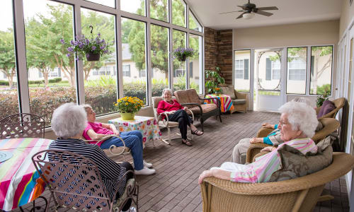 Residents enjoying the sun room at Azalea Estates of Fayetteville in Fayetteville, Georgia