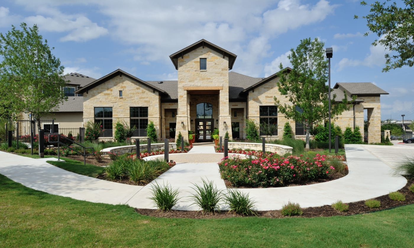 Clubhouse and beautiful garden at Cordevalle Apartments in Round Rock, Texas