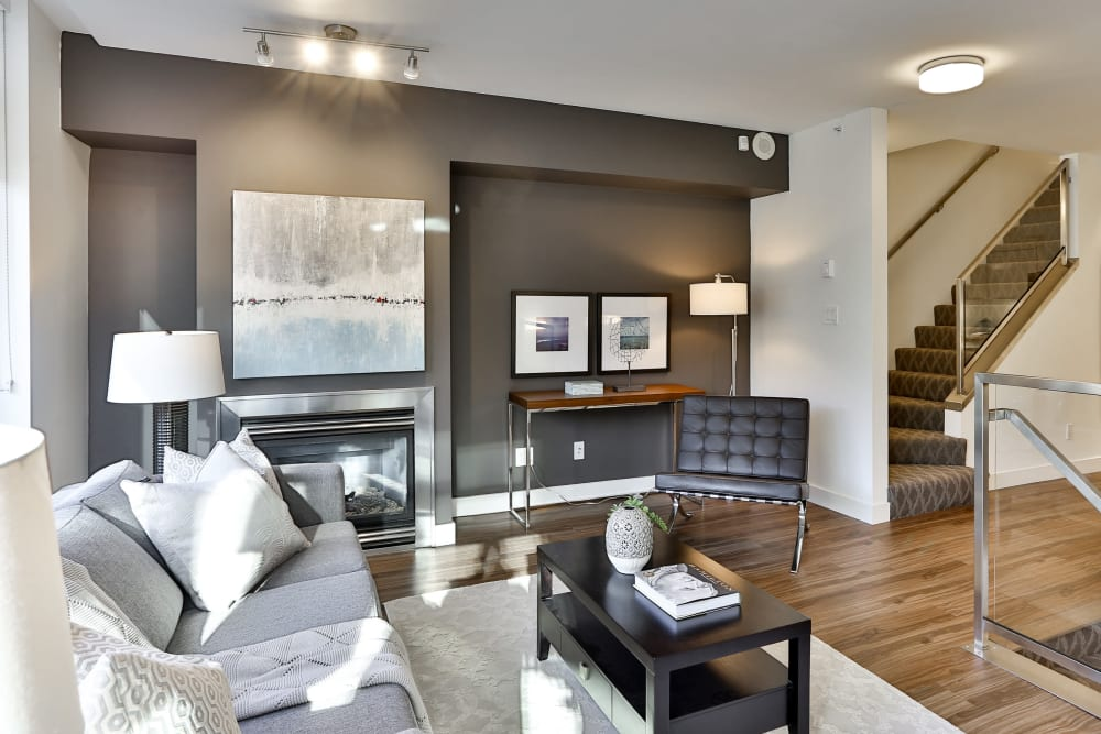 Modern furniture in model living room at Bayview at Coal Harbour in Vancouver, British Columbia