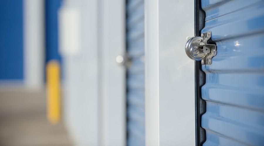 Storage units with blue doors and locks at KO Storage of Casper in Evansville, Wyoming