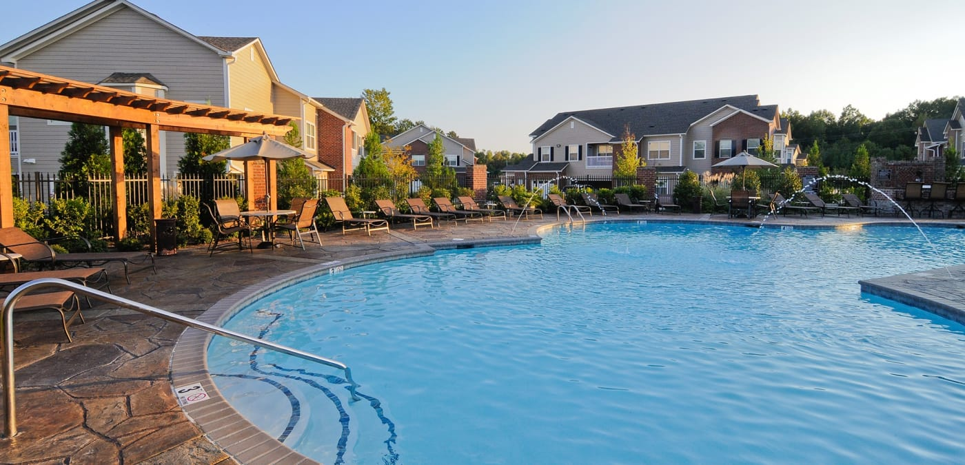 Evening time view of swimming pool at Villas at Houston Levee East Apartments in Cordova, TN