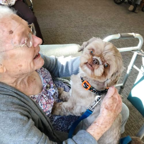 A resident with a lap dog at FountainBrook in Midwest City, Oklahoma