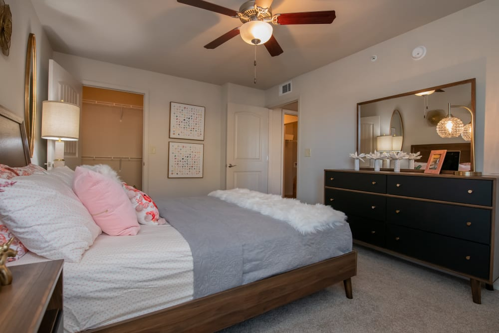 Bright and modern bedroom at Portico at Friars Creek Apartments in Temple, Texas