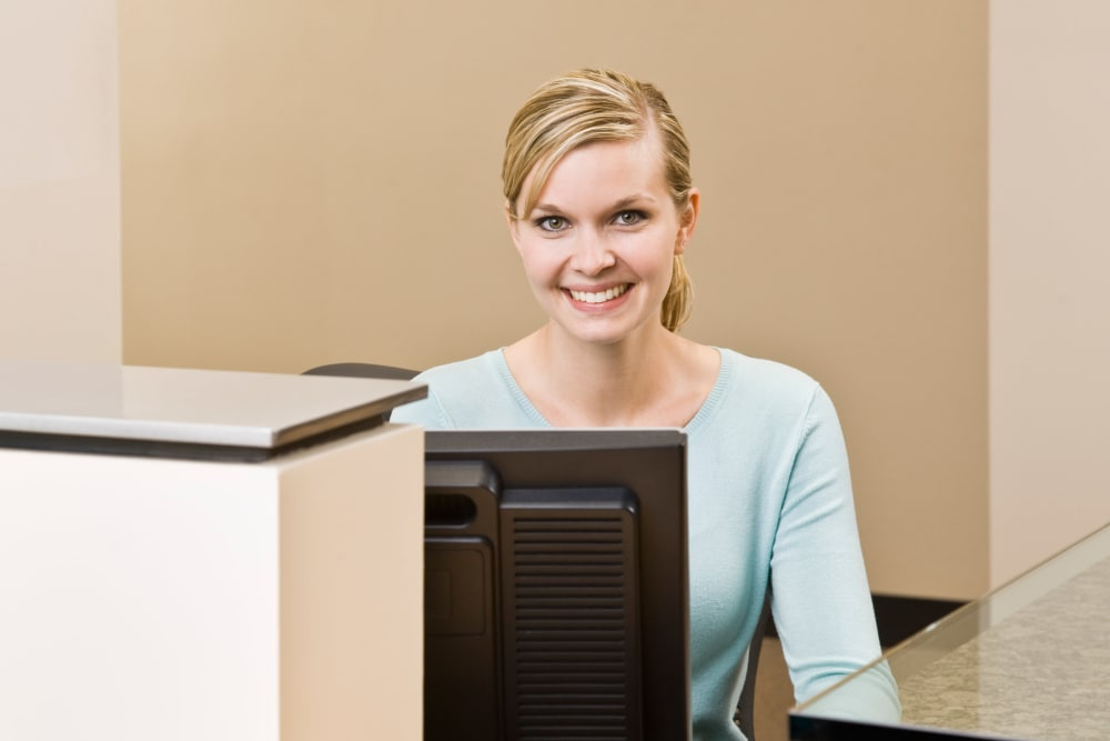 A women at the front desk at I-205 Mini Storage in Vancouver, Washington