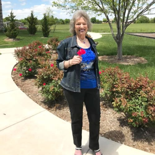 Resident standing outside at Oxford Villa Active Senior Apartments in Wichita, Kansas