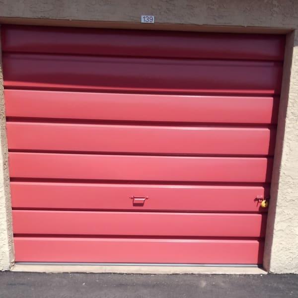 Outdoor storage unit with a red door at StorQuest Self Storage in Phoenix, Arizona