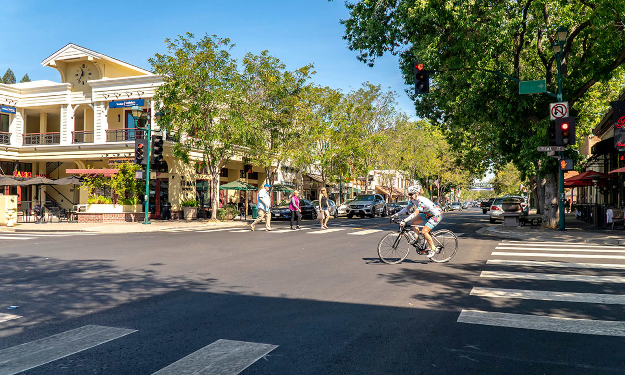 Resident biking downtown near Valley Plaza Villages in Pleasanton, California