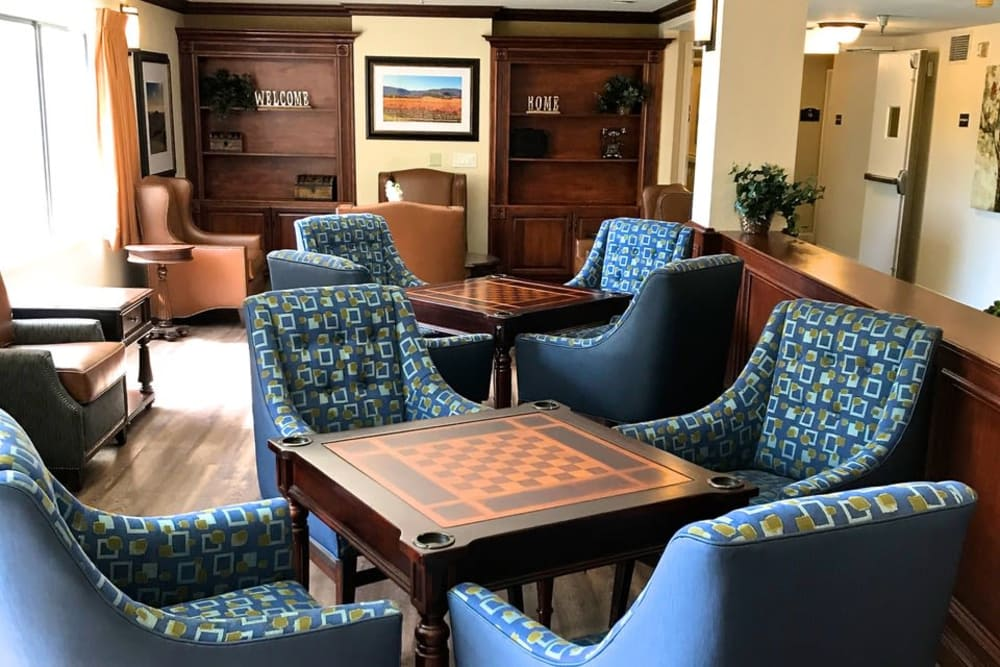 Comfortable games room with chess tables at Pacifica Senior Living San Leandro in San Leandro, California