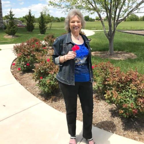 A resident in the garden at Oxford Villa Active Senior Apartments in Wichita, Kansas