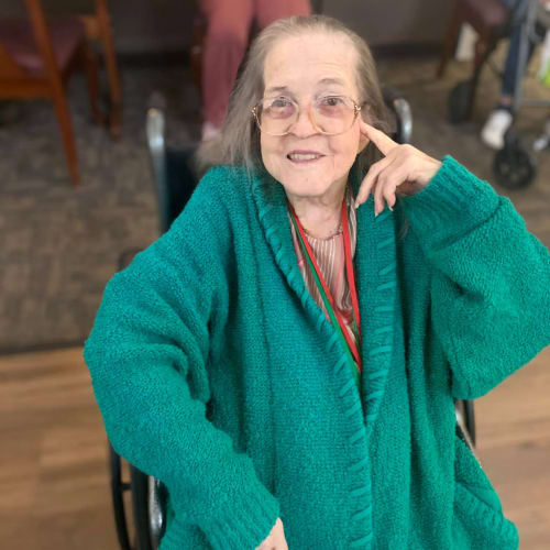 Resident in a big teal coat at Canoe Brook Assisted Living in Broken Arrow, Oklahoma