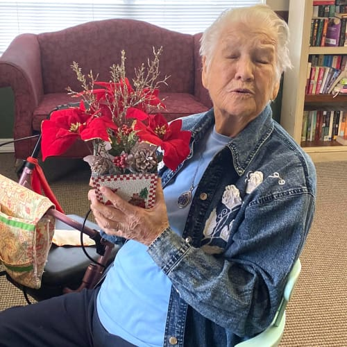 A resident holding flowers at Canoe Brook Assisted Living in Duncan, Oklahoma