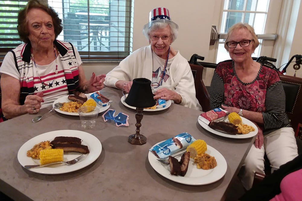 Ladies enjoying a meal together at Merrill Gardens at ChampionsGate in ChampionsGate, Florida.