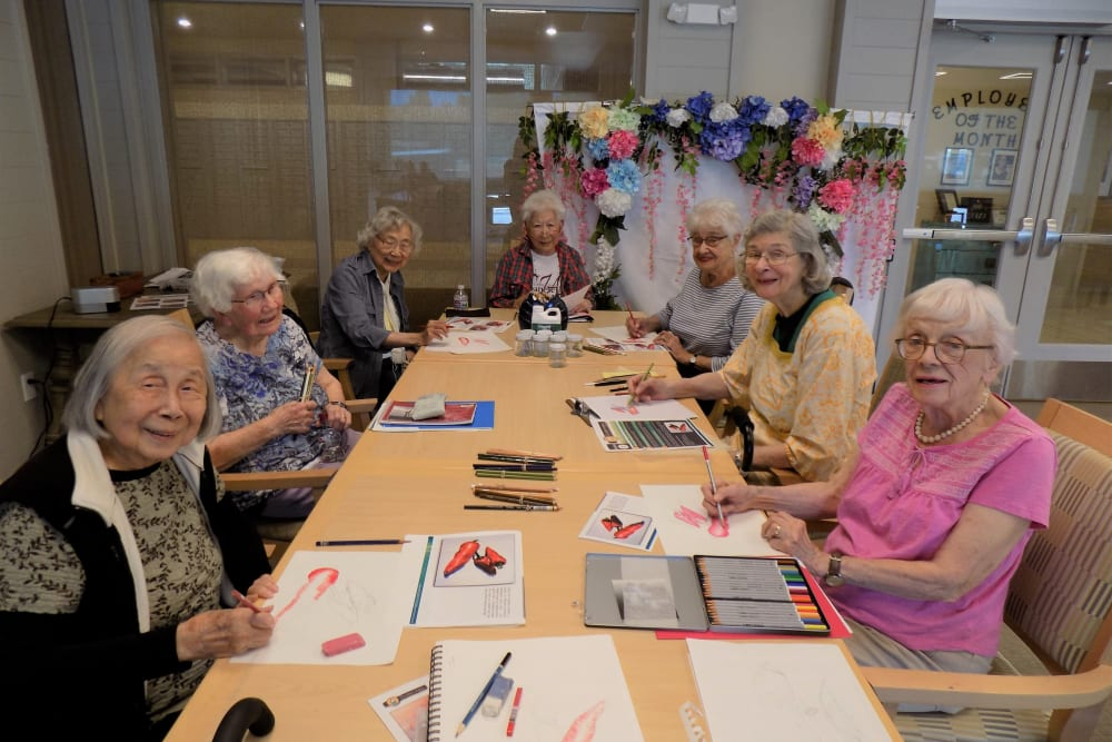 A group of residents painting at Merrill Gardens at Rockridge in Oakland, California.