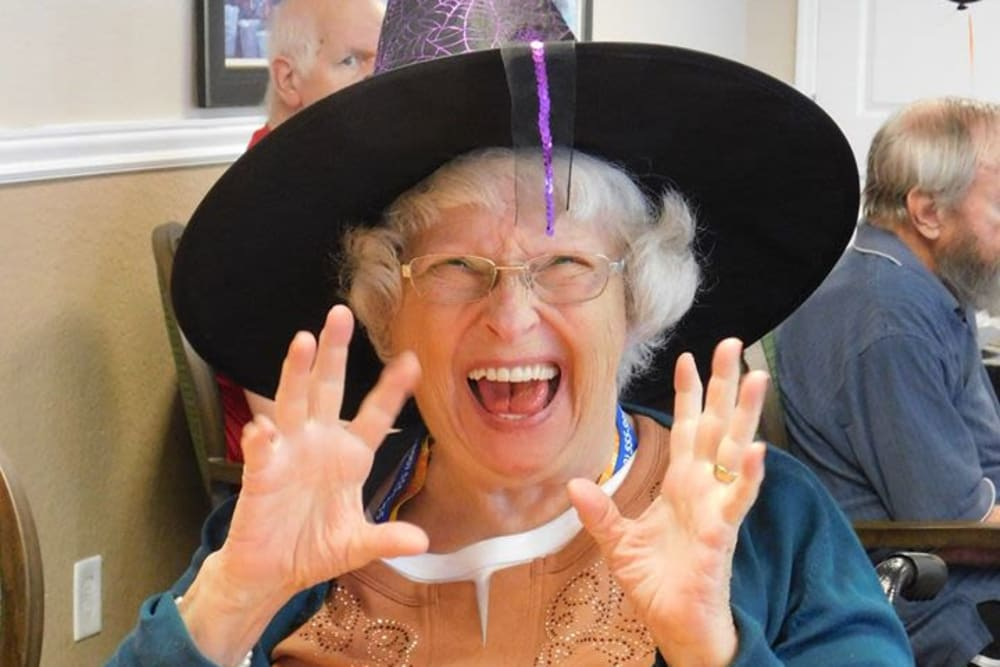 A resident in a witch hat on Halloween at Bradenton Oaks in Bradenton, Florida