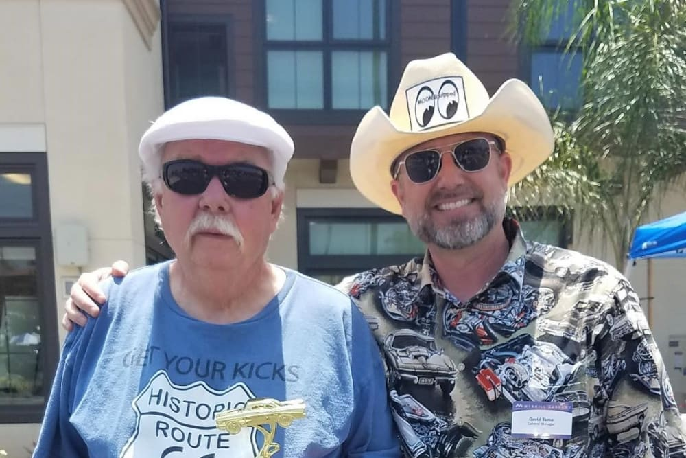 Resident and friend at the car show at Merrill Gardens at Rancho Cucamonga in Rancho Cucamonga, California.