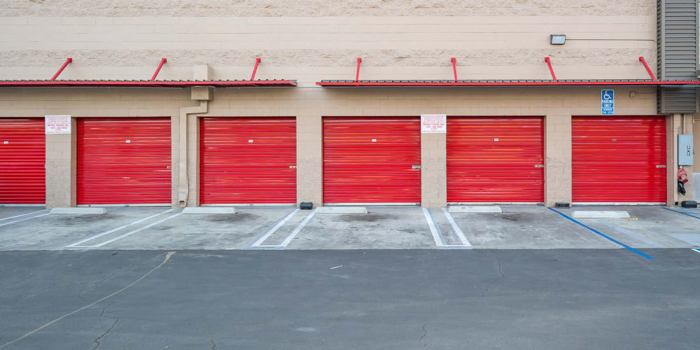 Exterior storage units with red doors at StorQuest Self Storage in Los Angeles, California