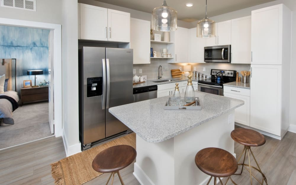 Granite countertops in model home's kitchen at The Elysian in St Johns, Florida