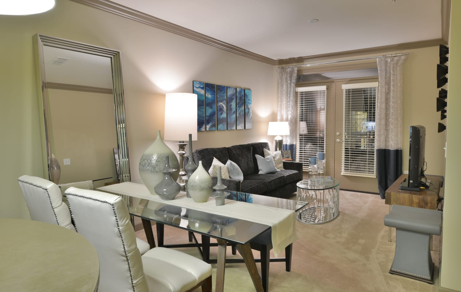 View of the dining area and living room in model home at Emory Point