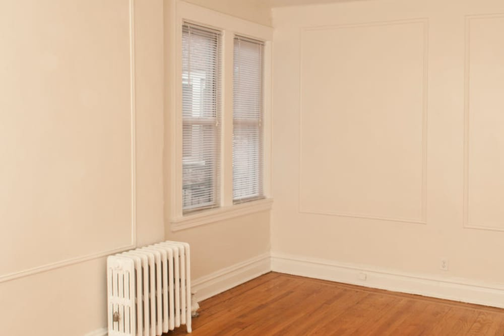 Room with hardwood floors at Murray Apartments in Paterson, New Jersey