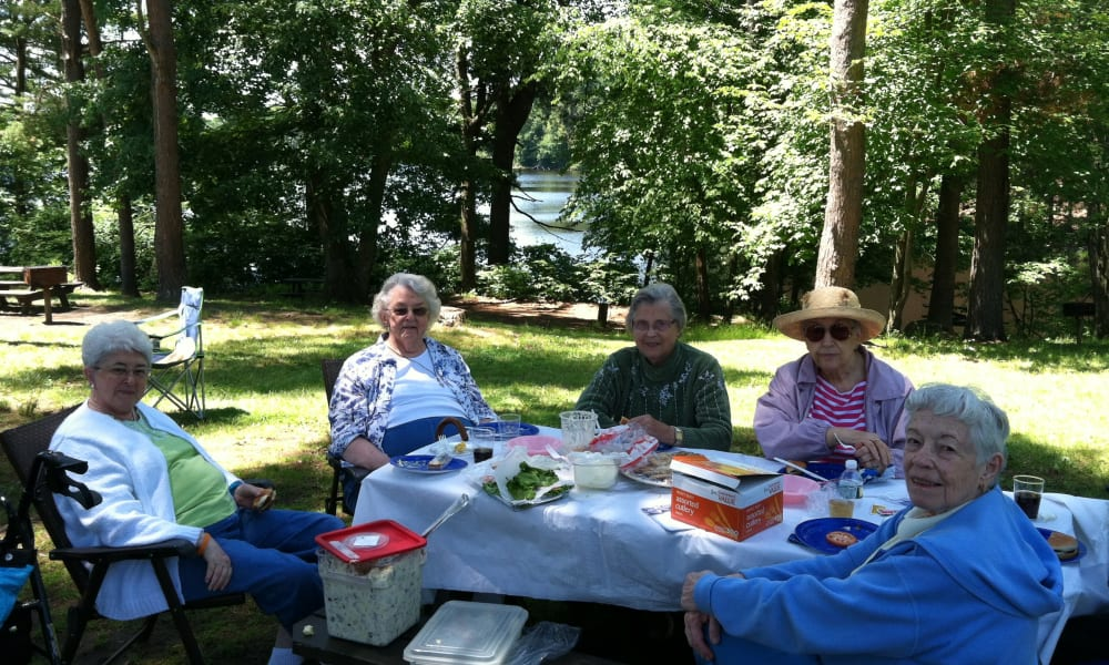 Outdoor patio gathering at Keystone Commons in Ludlow, Massachusetts