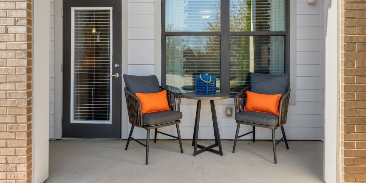 Private balcony with chairs and side table at Marq at Crabtree in Raleigh, North Carolina