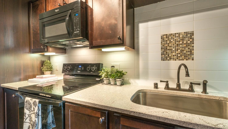 Beautiful granite countertops in a model home's kitchen at Union At Carrollton Square in Carrollton, Texas