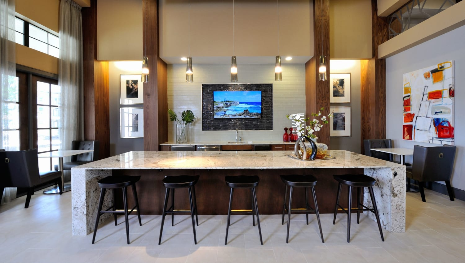 Resident lounge with TV at Olympus Falcon Landing in Katy, Texas
