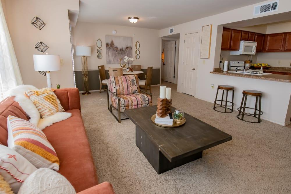 Bright living room at Nickel Creek Apartments in Tulsa, Oklahoma