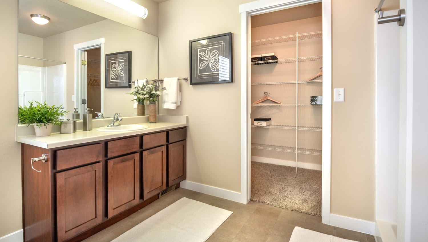 Bathroom at Olympus at the District in South Jordan, Utah features spacious closet