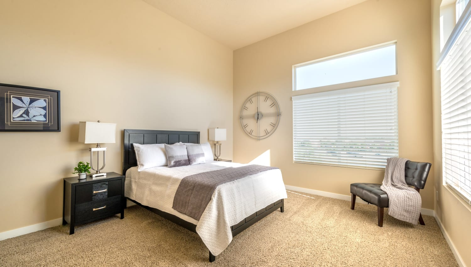 Spacious bedroom at Olympus at the District in South Jordan, Utah features a large window