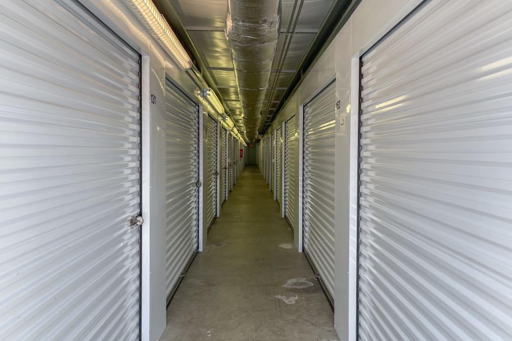 A long hallway of storage units inside of SecurityPlus Self Storage in Virginia Beach, Virginia