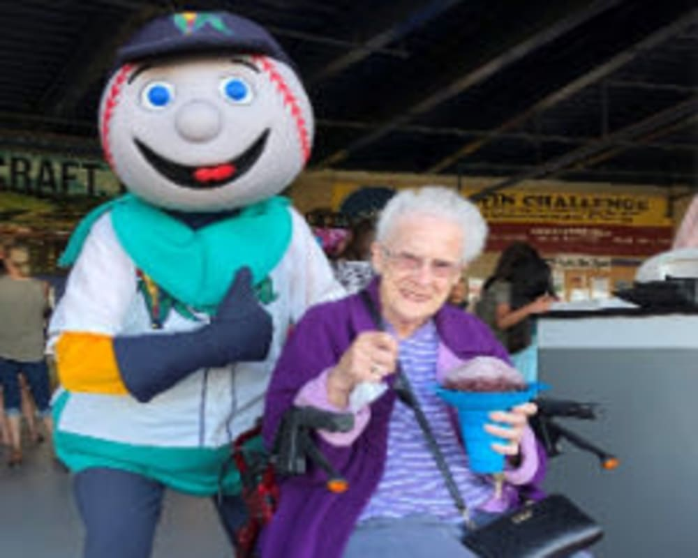 Resident Josie at a baseball game for her dare to dream event from Corridor Crossing Place in Cedar Rapids, Iowa.