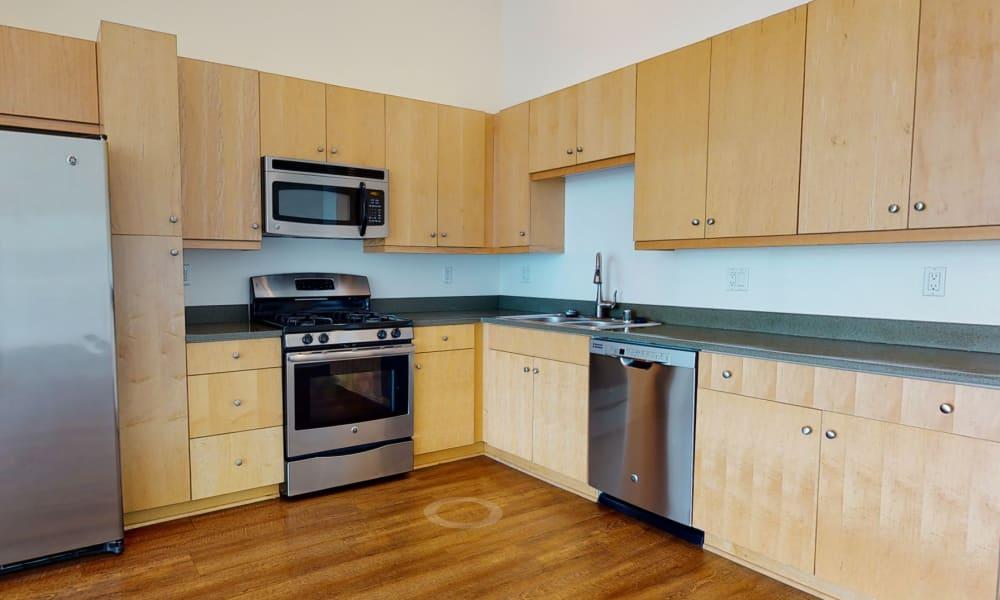 Hardwood floors in the kitchen of a loft home at Esprit Marina del Rey in Marina del Rey, California