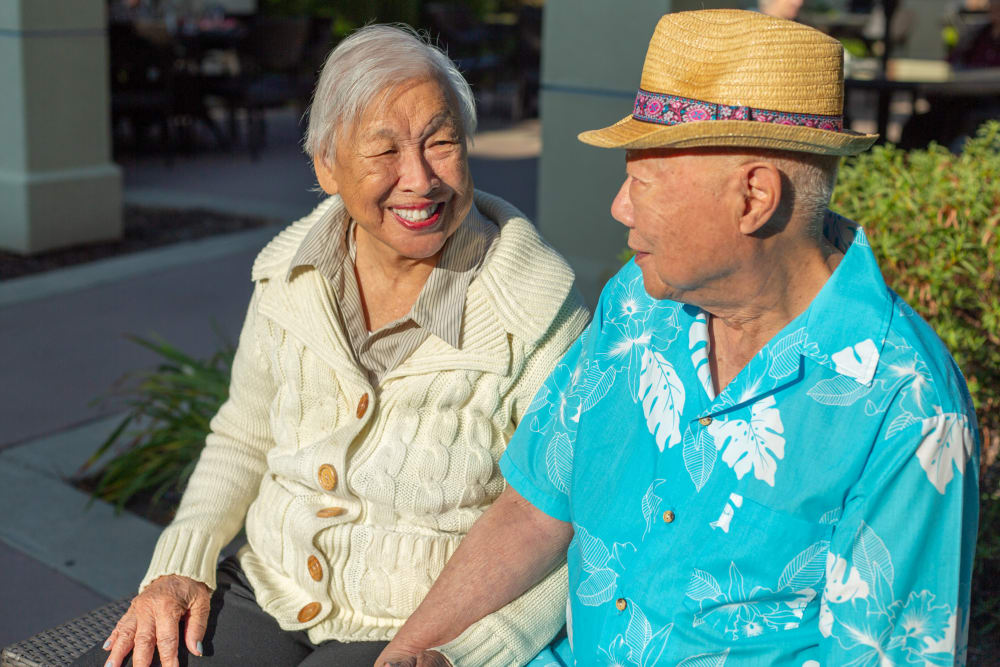 Couple sitting on patio at our senior living community in Santa Maria