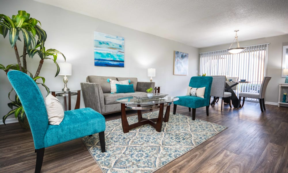 Living room with blue accents at Lexington Park Apartments in Smyrna, Georgia