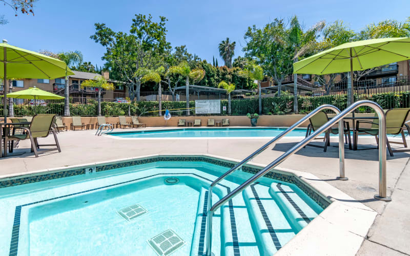 The sparkling swimming pool and hot tub on a sunny day at Hillside Terrace Apartments in Lemon Grove, California