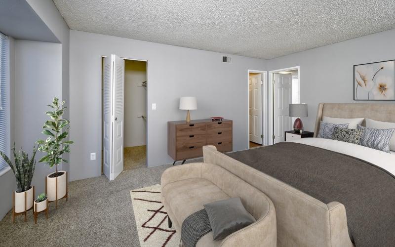 Spacious master bedroom with plush carpeting at Alton Green Apartments in Denver, Colorado