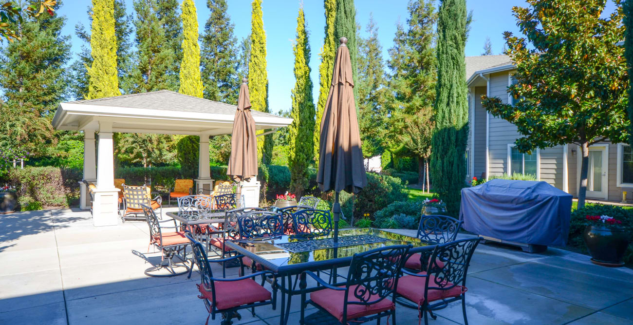 Exterior patio with chairs and tables at The Commons at Union Ranch in Manteca, California